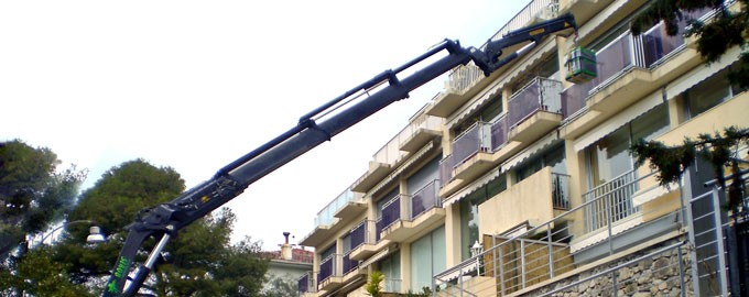 Delivery with arm crane across window or terrace